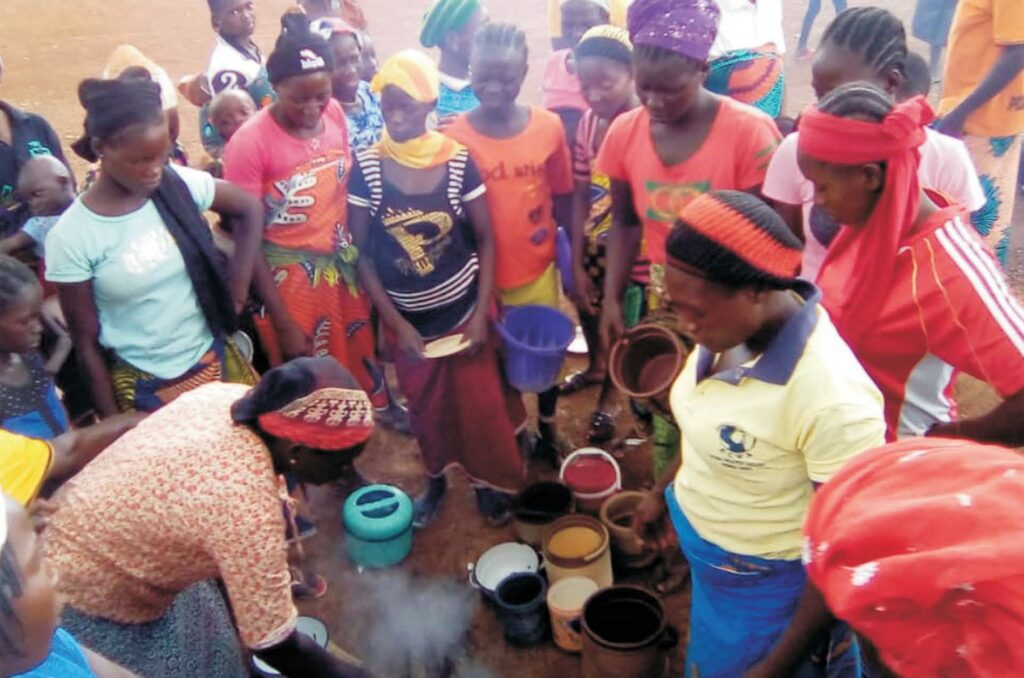 Women cooking in IDP Camp